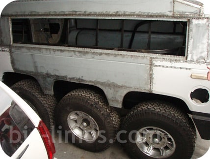 Triple axle Hummer H2 SUV stretch